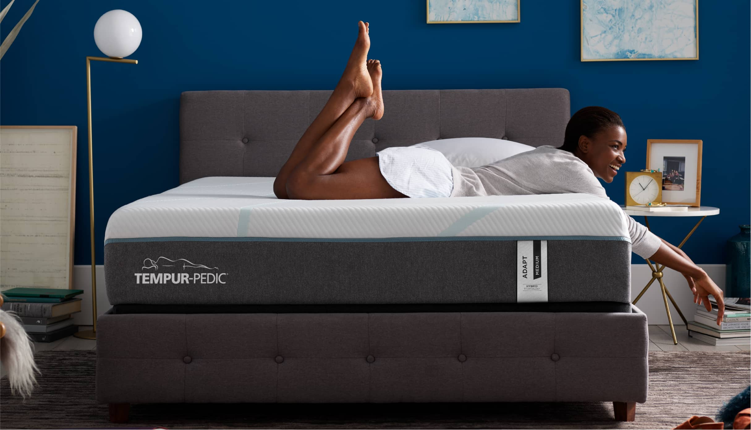 Woman laying on a Tempur-Pedic<sup>®</sup> mattress.